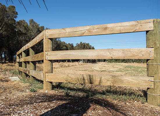 PERMAPole posts with treated timber rails